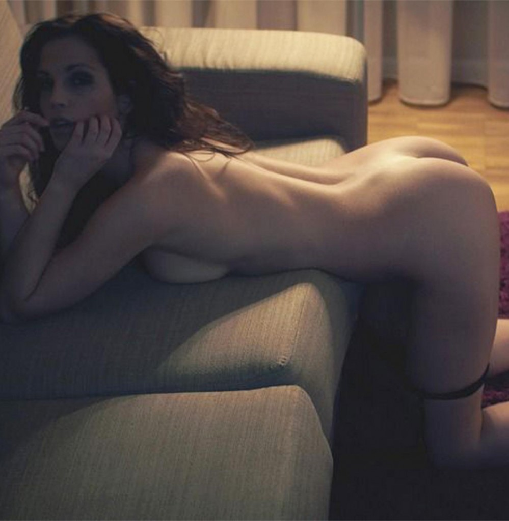 erotic nude girl bending over couch photographed by Simon Bolz