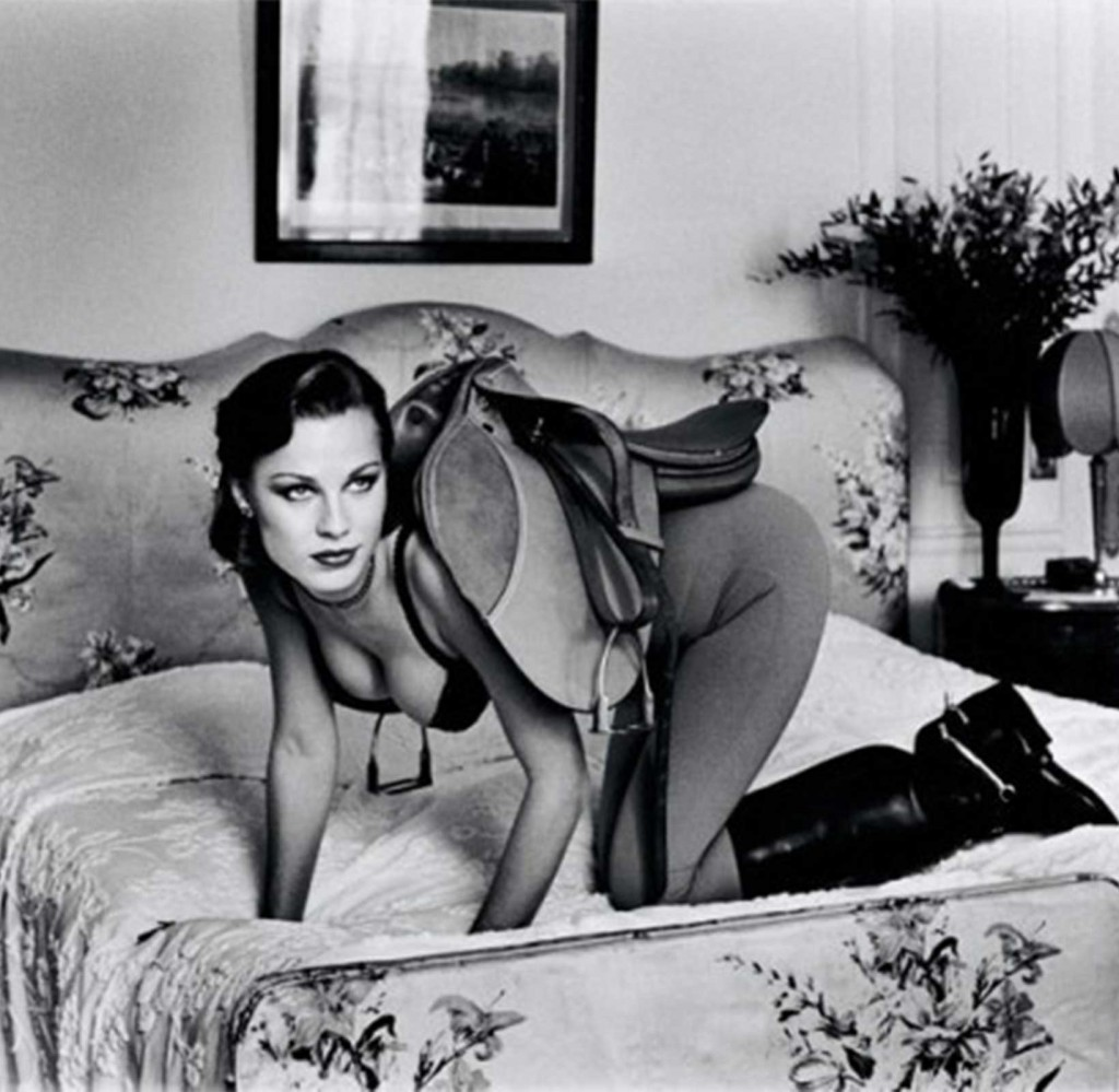 Model in horse saddle photograph by Helmut Newton in Paris in 1976