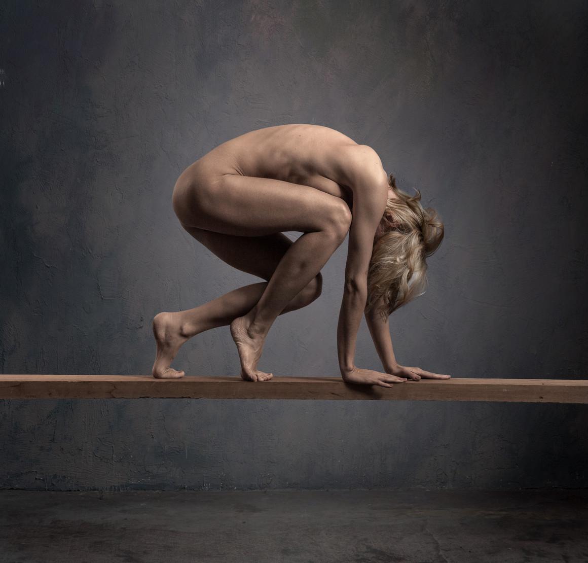 woman on wooden board in studio