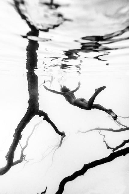 Natalie Floating in Bacalar